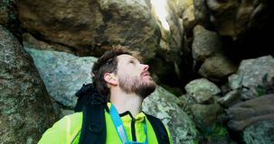 Male hiker exploring a cave 4k stock footage