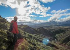 Male hiker hiking alone into the wild admiring volcanic landscape with heavy backpack. Travel lifestyle adventure wanderlust royalty free stock photos