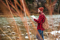 Male hiker holding map Stock Image