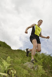 Male Hiker On Jogging Grassland Royalty Free Stock Photography