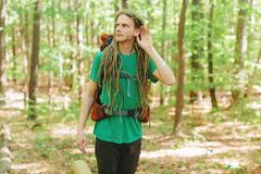 Male hiker listening to something. Male hiker listening for something in the forest Royalty Free Stock Photography