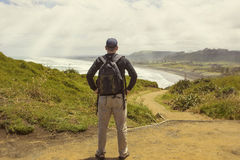 Male hiker looking at a beautiful ocean view Royalty Free Stock Image