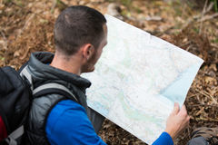 Male hiker looking at map Royalty Free Stock Images