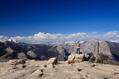 Male hiker looking at view from Yosemite Peak stock photography