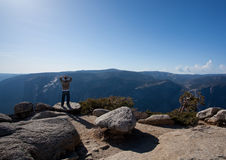 Male hiker looking at view from Yosemite Peak royalty free stock photo