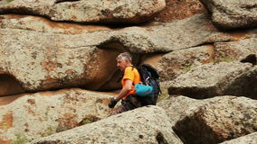 Male Hiker in Mountains. Rear view stock footage