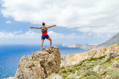 Male hiker with open arms, Crete Island, Greece Royalty Free Stock Photo