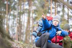 Male hiker pointing in forest Royalty Free Stock Photography