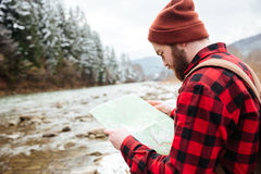 Male hiker reading map. Outdoors Royalty Free Stock Photography