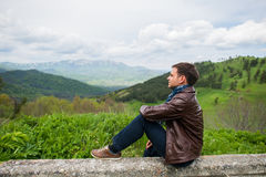 Male hiker relaxing on top of a mountain Stock Image