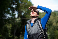 Male hiker shielding his eyes Stock Image