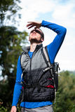 Male hiker shielding his eyes Stock Images