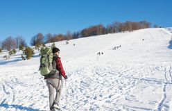 Male hiker on snow covered mountain. Male hiker with backpack on snow covered mountain Stock Image