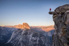 Free Male Hiker Standing On Overhanging Rock At Glacier Point, Yosemite National Park, California, USA Stock Images - 111026804