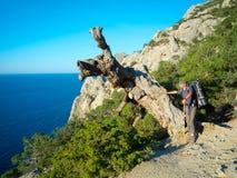 Male hiker on a stony sea shore Royalty Free Stock Photos