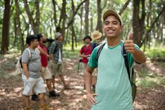 Male hiker thumb up. Male hiker with green tshirt showing thumb up to camera Stock Images