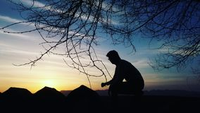 Male hiker on top of mountain Stock Images