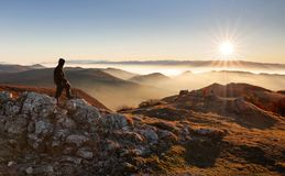 Male hiker at the top of the mountain at sunset Stock Images