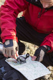 Male hiker using compass and map in forest Stock Images