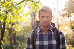 Male hiker walking in the forest. Portrait of a male hiker walking in the forest Stock Images