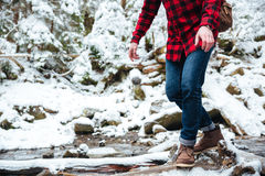 Male hiker walking on mountain river Stock Photography