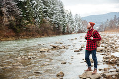 Male hiker walking on the river Stock Photography