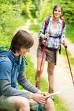 Male hiker watching map waiting for girl Stock Photos