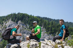 Male hikers on the mountain cliff Stock Photography