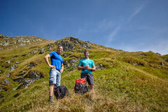 Male hikers on a mountain trail. Male hikers having a break on a mountain trail Stock Photos
