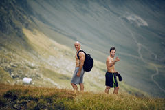 Male hikers on mountain trail Royalty Free Stock Image