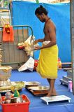 Male Hindu prepares for dinner in temple Stock Photo