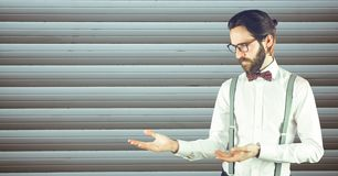 Male hipster in formals gesturing against wall Stock Photography