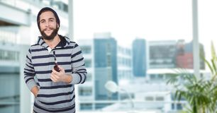 Male hipster holding smoking pipe in city Stock Photo