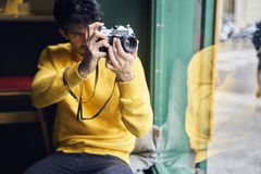 Male hipster tourist dressed in trendy clothing Stock Image