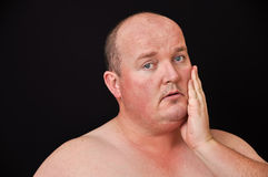 Male in his 30's overweight on black background Royalty Free Stock Photo