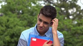 Male Hispanic Student Teenager Confused. A handsome hispanic male teen stock footage