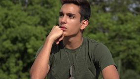 Male Hispanic Teenage Soldier Recruit Thinking. A handsome hispanic male teen stock video footage