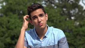 Male Hispanic Teenager Talking. A handsome hispanic male teen stock footage