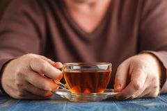 Male hold cup of hot tea. Morning time, Male hold cup of hot tea Stock Images