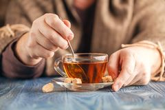 Male hold cup of hot tea. Morning time, Male hold cup of hot tea Royalty Free Stock Photo
