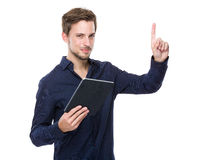 Male hold tablet and finger point up Royalty Free Stock Image