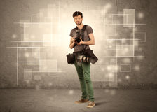 Male holdig professional camera with lens Royalty Free Stock Photography