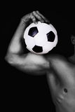 Male holding a ball. Monochrome  image of torso and ball Stock Photo