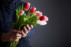 A Man holding bunch of tulips stock photo