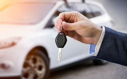Male holding car keys. With car on background royalty free stock photos