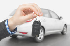 Male holding car keys with remote control system Royalty Free Stock Image