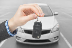 Male holding car keys with remote control system Royalty Free Stock Photos