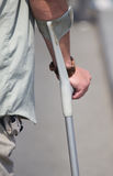 Male holding a crutch Stock Photos