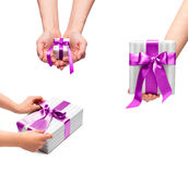 Male holding gift boxes with a bow Royalty Free Stock Photos
