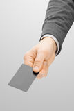 Male holding in hand blank card of grey color Stock Photography